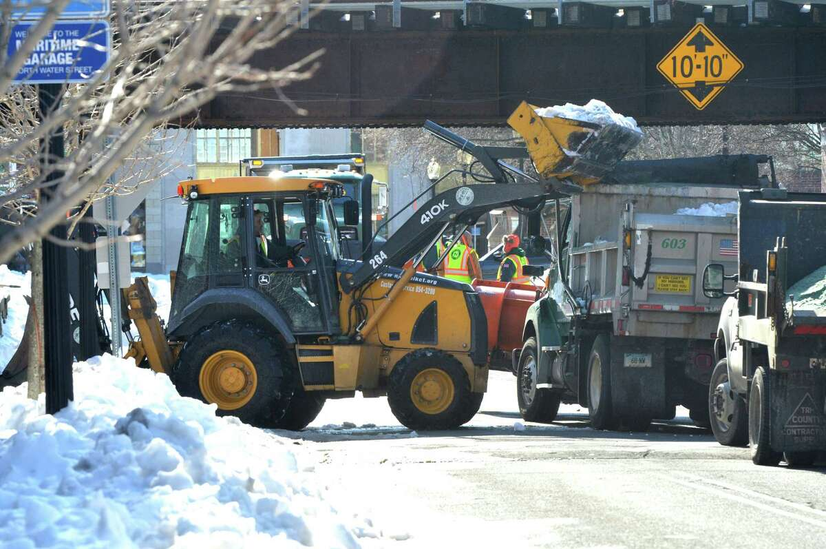 Crews with the Norwalk Department of Public Works use loaders, plows and shovels to manage the removal of snow from the edge of streets and sidewalks on Marshall St. and around SONO on Thursday March 16 in Norwalk Conn.