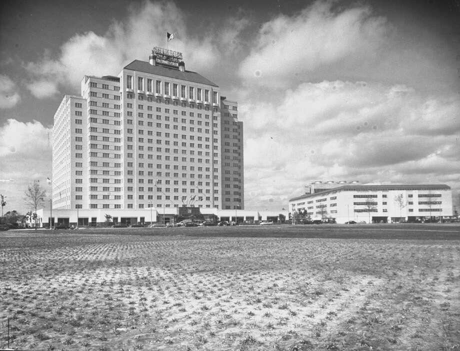 Exterior view of the Shamrock Hotel (left) and it's attendant, parking garage and convention center (right), Houston, Texas, March 1949. The hotel, built by oilman Glenn McCarthy, opened on St. Patrick's Day, 1949. Photo: Joseph Scherschel/The LIFE Picture Collection/Getty Images