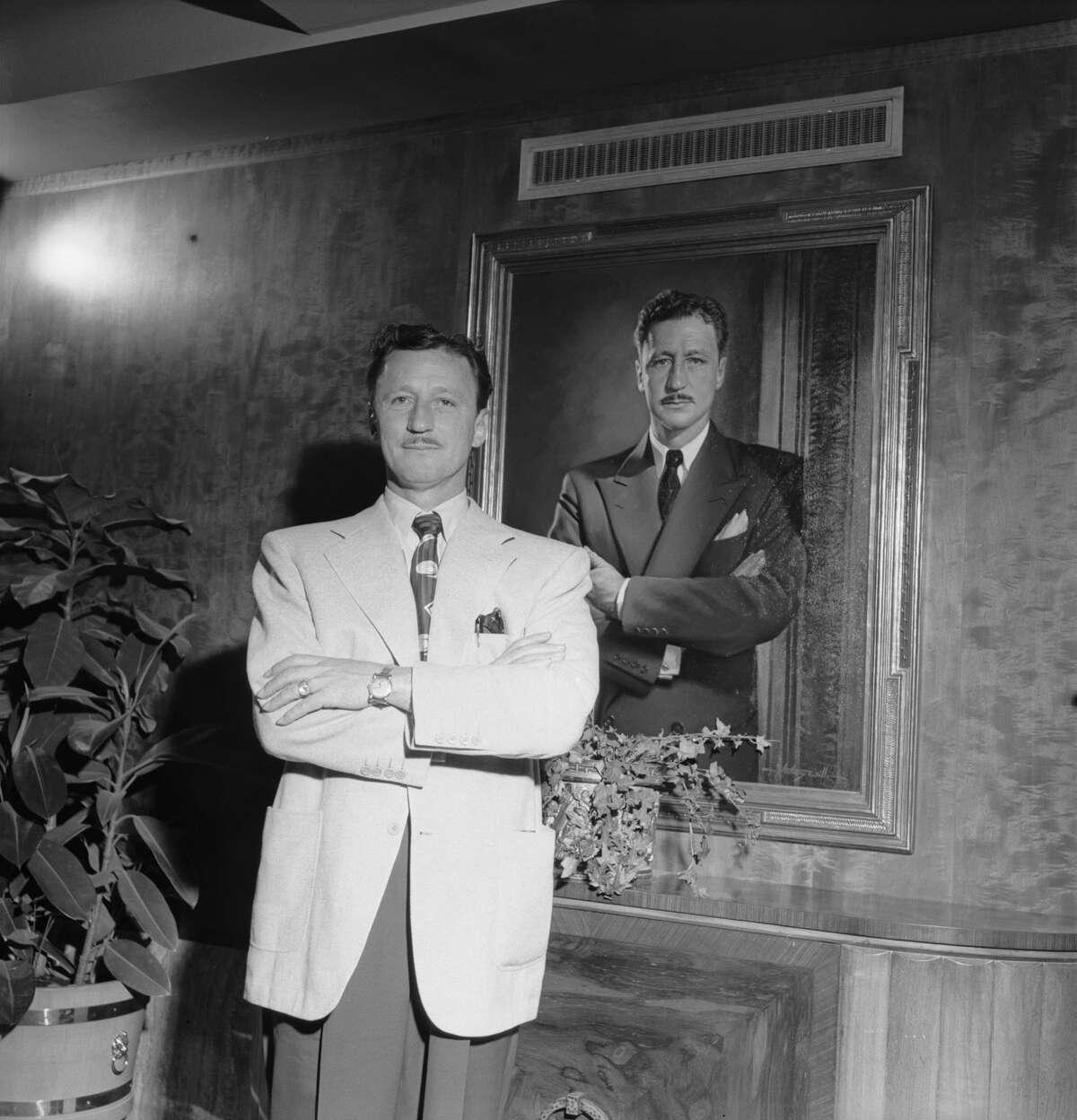 Oilman and Shamrock Hotel owner Glenn McCarthy posing at the Shamrock Hotel in Houston, Texas, March 1949.
