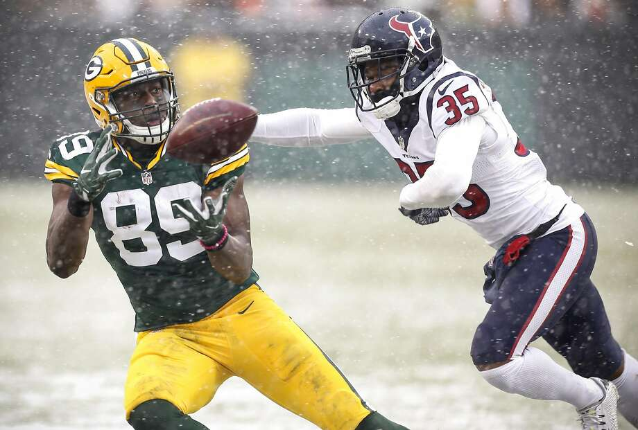 Jared Cook hauls in a reception in December against the Texans. Photo: Brett Coomer, Houston Chronicle