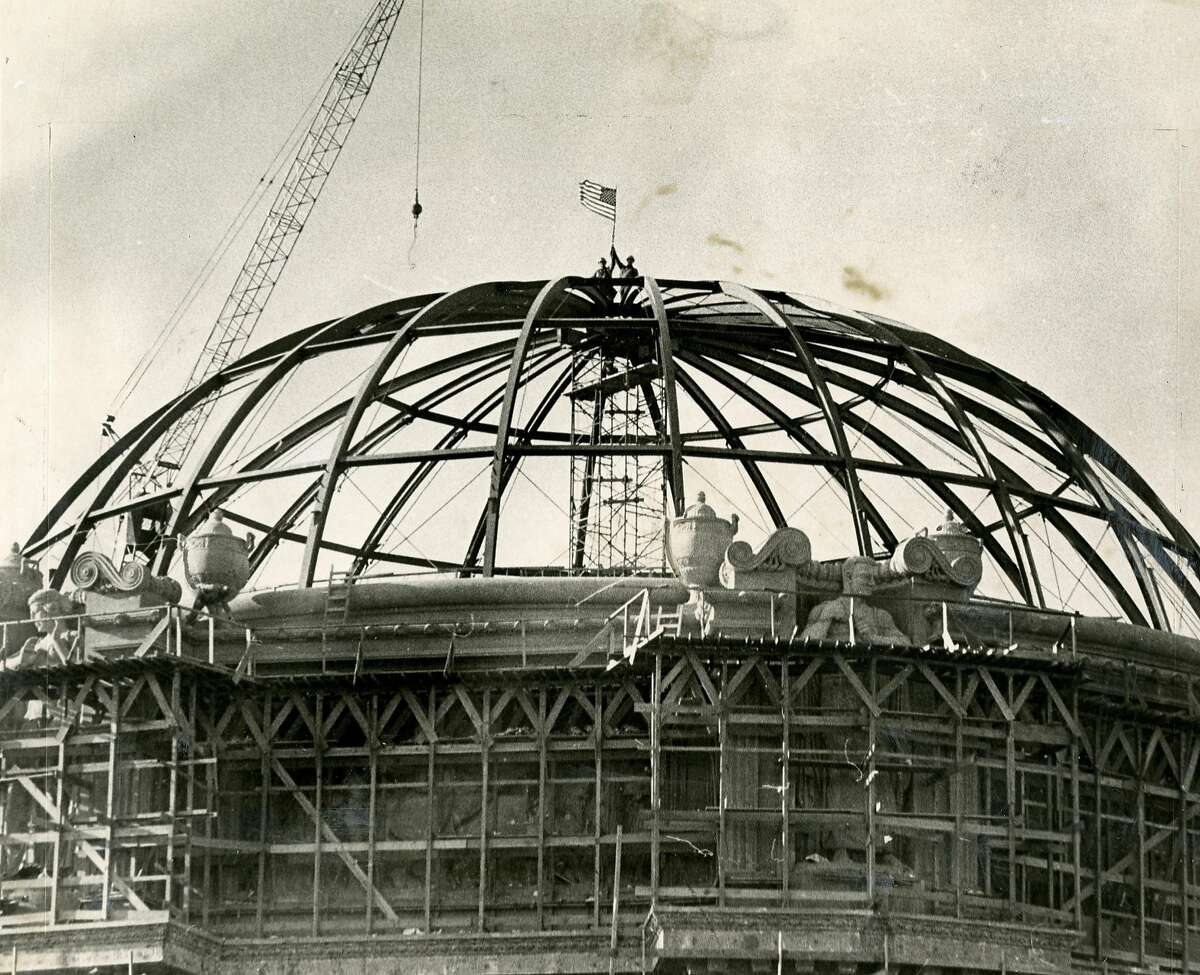 Steel topping shown during the reconstruction of the San Francisco Palace of Fine Arts. Steelworkers, Fred Anthony and Ron Jones (L-R) are shown atop the dome. December 22, 1966