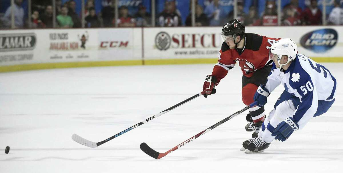 Devils' Reid Boucher, left, and Marlies' Viktor Loov chase a loose puck during Game 5 of the American Hockey League quarterfinal playoff series on Thursday, May 12, 2016, at Times Union Center in Albany, N.Y. (Cindy Schultz / Times Union) ORG XMIT: MER2017031614504277