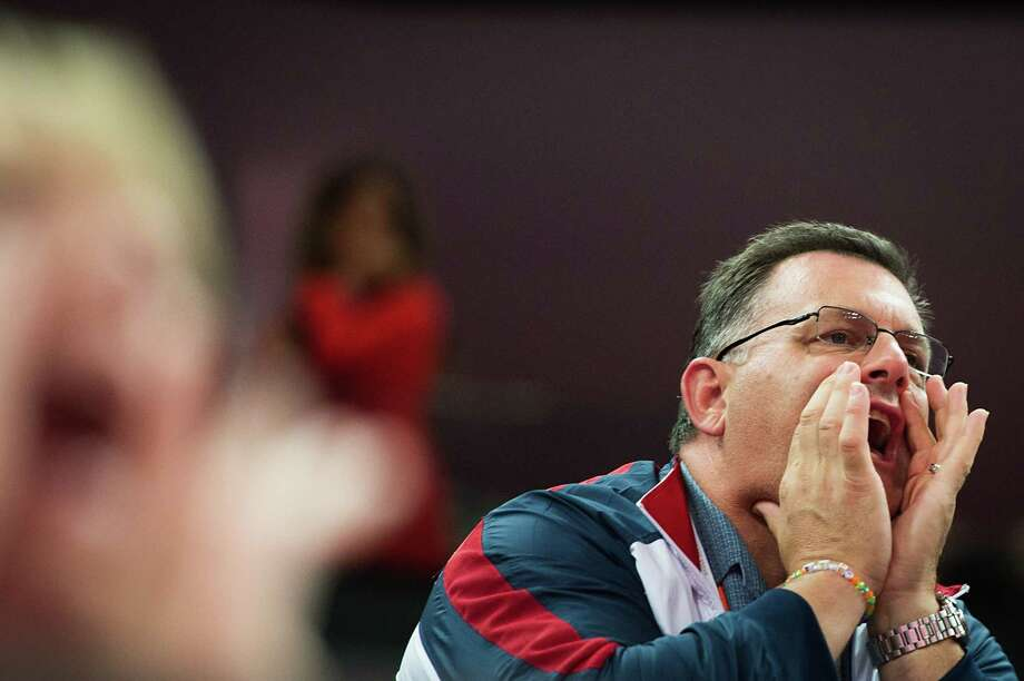 USA Gymnastics president Steve Penny shouts encouragement to the team during the men's gymnastics team final at the 2012 London Olympics on Monday, July 30, 2012. The USA finished in 5th place. Photo: Smiley N. Pool, Houston Chronicle / © 2012  Houston Chronicle