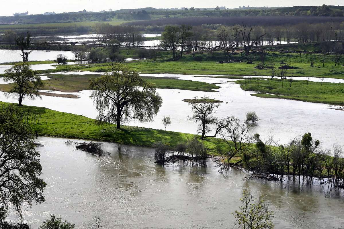 The Tuolumne river near Hickman, Ca. on Thurs. March 16, 2017. The Turlock Irrigation District opposes the state's proposal to keep more water flowing in the Tuolumne River and other California rivers to help the fish and their natural habitat but the district supports an alternative plan that preserves water for agriculture while still protecting fish.