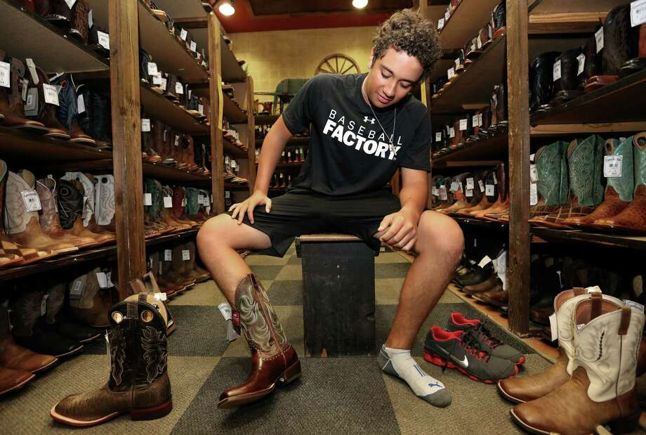 Diego Rivera, 18, at Cavender's Boot City. Photo: Yi-Chin Lee, Houston Chronicle / © 2017  Houston Chronicle