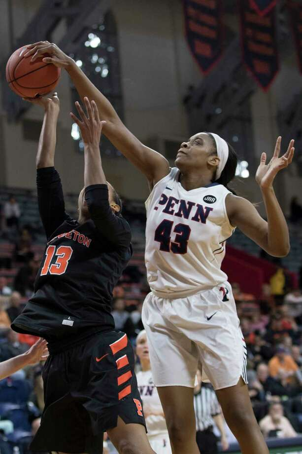 Pennsylvania's Michelle Nwokedi, right, blocks the shot attempt by Princeton's Vanessa Smith, left, during the first half an NCAA college basketball championship game in the Ivy League Tournament, Sunday, March 12, 2017, in Philadelphia. Pennsylvania won 57-48. (AP Photo/Chris Szagola) Photo: Chris Szagola, FRE / FR170982 AP