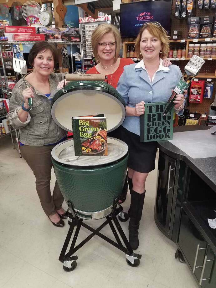 "Devon Alexander, Dorothy Alspaugh and Millie Garrison, from left to right, have just learned what they're standing behind is not just a grill, it's the ""Big Green Egg,"" the ultimate cooking experience. Alspaugh Ace Hardware in Kingwood donated the ""Big Green Egg"" to Humble Area Assistance Ministries where it will be raffled off at HAAM's annual Pillars of the Community Banquet on March 31. Photo: Courtesy"