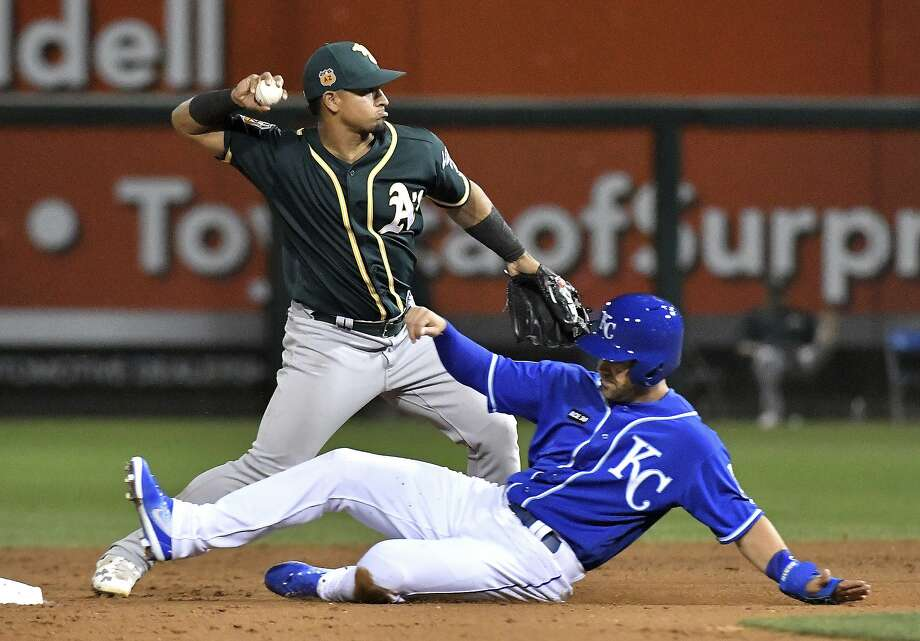 Kansas City Royals' Whit Merrifield is forced out at second by Oakland Athletics shortstop Franklin Barreto on a ball hit by Samir Duenez during the seventh inning of a spring training baseball game Friday, March 10, 2017, in Surprise, Ariz. (John Sleezer/The Kansas City Star via AP) Photo: John Sleezer, Associated Press