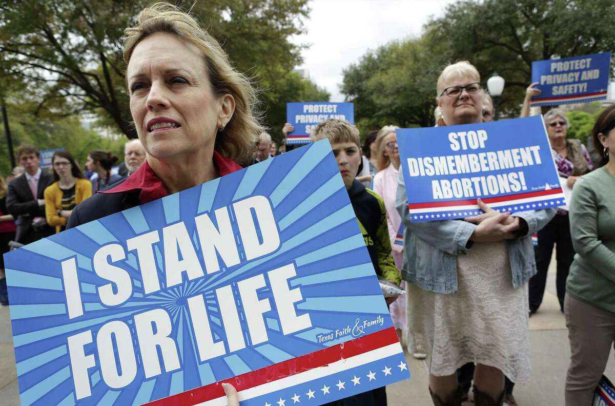 Dr. Linda Flower of Tomball holds a sign as she and others listen to the Rev. Rafael Cruz, father of U.S. Sen. Ted Cruz, at the Faith and Family Rally at the state Capitol in Austin on Thursday, March 16, 2017.