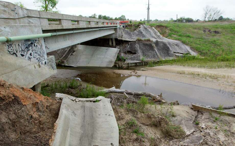 Damage to the closed Buffalo Springs Bridge near the Waterstone subdivision is seen Thursday, March 16, 2017, in Montgomery. The bridge was shut down after it was damaged by flooding in May 2016. According to Font, the flooding filled in the channel with silt and other debris. Photo: Jason Fochtman, Staff Photographer / © 2017 Houston Chronicle