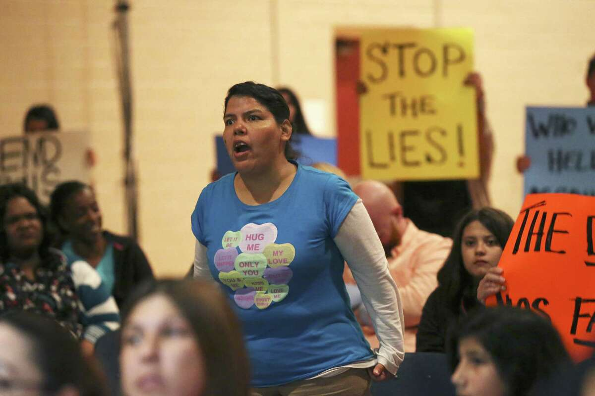 Annette Hernandez objections to a student not allowed to speak as parents and students give their comments to two board members of the San Antonio School for Inquiry & Creativity, (SASIC), at their Preparatory Academy campus on Fredericksburg Road, Wednesday, Feb. 15, 2017. The student was not signed up to speak. Tensions are bubbling over at SASIC, a small charter district beset by an array of complaints of corruption, mismanagement and negligence. Students and parents accuse the district of a range of offenses, including serving spoiled food to students, not providing toilet paper and soap in the bathrooms, and not paying employees, among many others. On Wednesday, parents and community members will express their grievances at an open forum before the board. On Wednesday, parents and community members expressed their grievances at an open forum before board president Denise Fritter and member Nathan Wiegreffe.