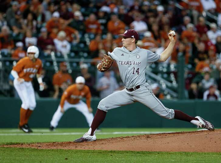 Texas A&M's John Dosakis pitches with runners on base in the fourth inning against Texas at UFCU Disch-Falk Field in Austin on March 14, 2017.