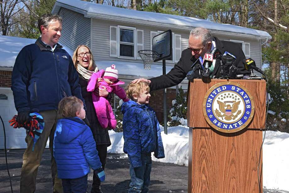 "U.S. Senate Minority Leader Charles Schumer, right, speaks at the home of Dan and Jennifer Jeram and their three children James, 5, second from right, Benjamin, 3, and Madeline, 6-mos.-old on Thursday, March 16, 2017 in Clifton Park, N.Y. Here Schumer is reassuring James after James asked the question ""Is Donald Trump going to take our money."" The senator is launching a push to preserve popular, but increasingly at-risk tax deductions Saratoga homeowners and taxpayers depend upon to keep Capital RegionOs cost of living in-check.( Lori Van Buren / Times Union) Photo: Lori Van Buren / 20039986A"
