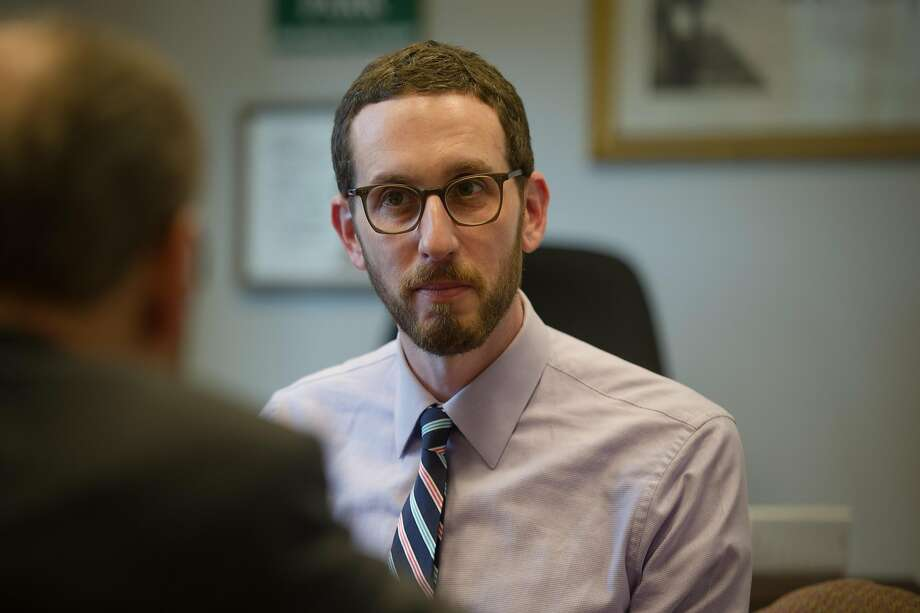 Sen. Scott Wiener, D-San Francisco, talks with Sen. Jerry Hill, D-San Mateo, in his office in the state Capitol in Sacramento, Calif. on Thursday, March 16, 2017. Photo: Chris Kaufman, Special To The Chronicle