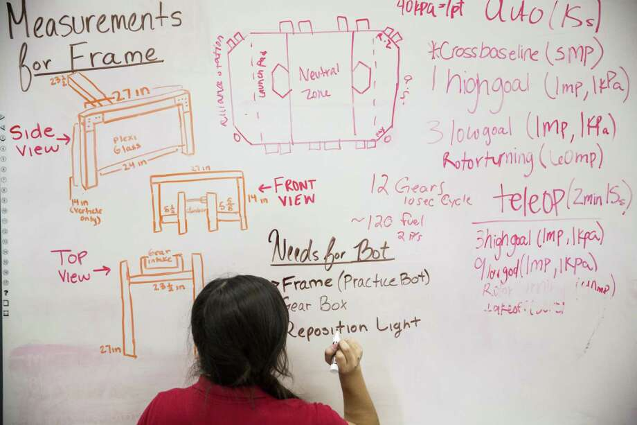 Gaby Garcia writes down what the team has left to do before competing while waiting to bag the Young Women's Leadership Academy's team robot at the Young Women's Leadership Academy in San Antonio, Texas on February 21, 2017. Photo: Carolyn Van Houten, Staff / San Antonio Express-News / 2017 San Antonio Express-News