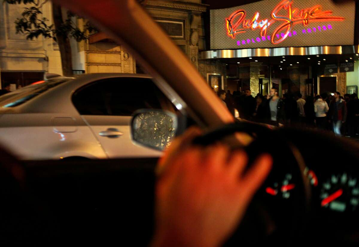 Vajra Granelli, an inspector with the Entertainment Commission, drives by Ruby Skye, one of the busiest clubs in San Francisco, Calif., November 5, 2011. Granelli patrols every week, stopping at clubs and bars to check for noise and violence issues.