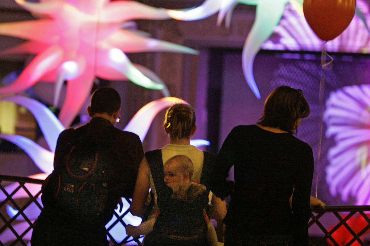 On the top floor of the Ruby Skye dico people who didnot want to dance watched the action on the dance floor. San Fracisco nightclub Ruby Skye hosts the city's first Baby Loves Disco event,