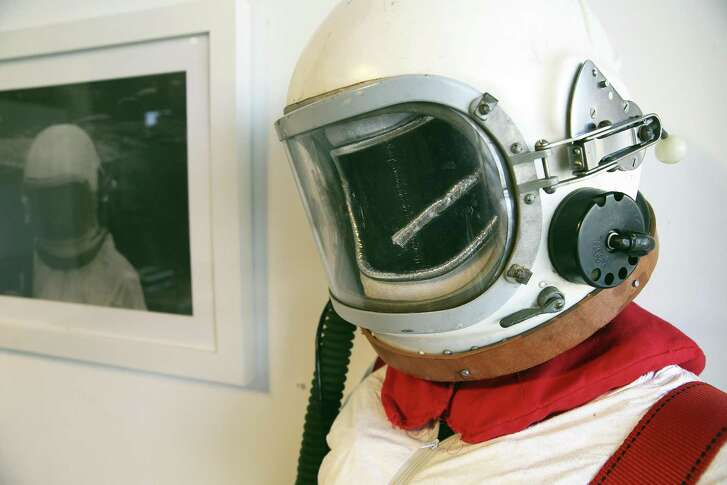 """Artist Christine Zuercher purchased a 1950s Cosmonaut helmet on Ebay that she used to make a space suit for her exhibition """"Distant Transmissions."""""""