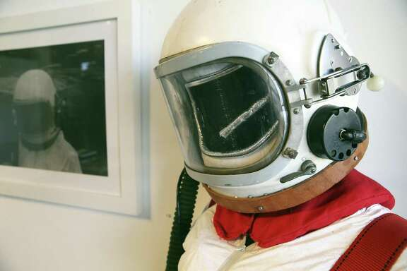 "Artist Christine Zuercher purchased a 1950s Cosmonaut helmet on Ebay that she used to make a space suit for her exhibition ""Distant Transmissions."""