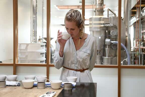 Co-owner and CEO Lauren Crabbe (right) does the daily taste test at Andytown Roasting Co. on Thursday, March 16, 2017, in San Francisco, Calif.