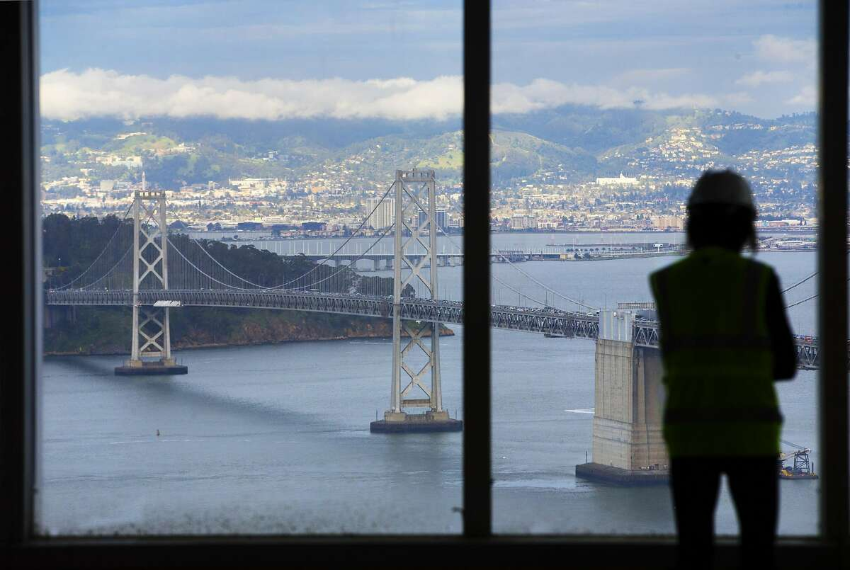 Mirjam Link, Senior Project Manager for Development for Boston Properters, looks out from 33rd floor of the Salesforce Tower toward the Bay Bridge in San Francisco, Calif., on Wednesday, March 15, 2017. The building, once completed, will be the tallest in San Francisco.