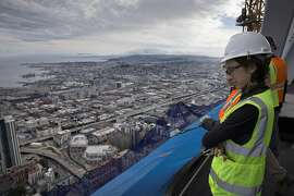 Mirjam Link, Senior Project Manager for Development for Boston Properters, looks out from top floor of the Salesforce Tower toward the Bay Bridge in San Francisco, Calif., on Wednesday, March 15, 2017. The building, once completed, will be the tallest in San Francisco.