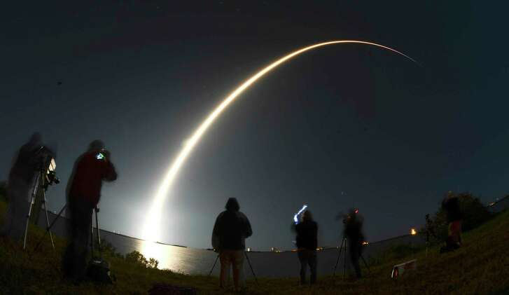 A SpaceX Falcon 9 rocket lifts off early Thursday from Pad 39A at Kennedy Space Center in Florida. The rocket was carrying the Echostar XXIII communications satellite. An upgraded Falcon 9 is expected to fly at year's end.