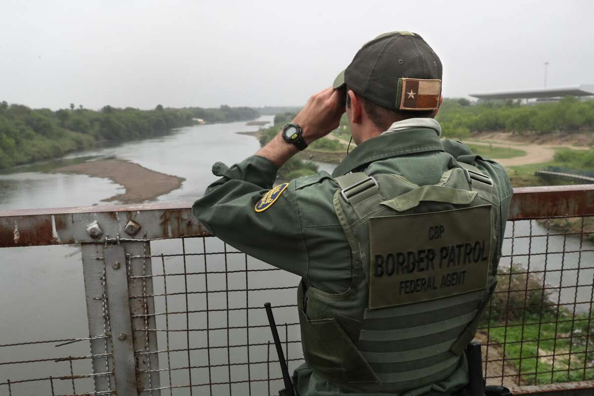 ROMA, TX - MARCH 13: A U.S. Border Patrol agent scans the U.S.-Mexico border while on a bridge over the Rio Grande on March 13, 2017 in Roma, Texas. The Border Patrol has reported that illegal crossings from Mexico have dropped some 40 percent along the southwest border since Donald Trump took office. (Photo by John Moore/Getty Images)