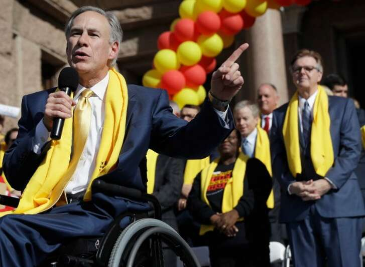 Gov. Greg Abbott and Lt. Gov. Dan Patrick stand on the Capitol steps at a Jan. 24 School Choice Rally. CREDIT: AP Photo/Eric Gay