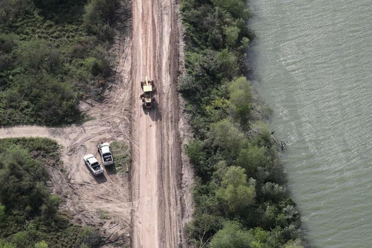 A road crew improves a road along the U.S.-Mexico border on March 16, 2017 in Hidalgo, Texas. There has been great speculation on exactly where a border wall, promised by President Trump, would be built near the Rio Grande, which forms the border between Texas and Mexico. U.S. Customs and Border Protection announced that illegal crossings along the southwest border with Mexico dropped 40 percent during the month of February. (Photo by John Moore/Getty Images) Click through the slideshow to see more photos from the U.S.-Mexico border.