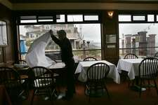 View of the outside as tables are being set for dinner at Miramar Beach restaurant on Wednesday, March 15, 2017, in Half Moon Bay, Calif.