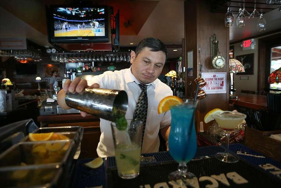Bartender Spencer Vela makes a mojito at Miramar Beach Restaurant. Photo: Liz Hafalia, The Chronicle