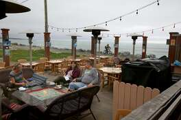 View of outside patio at Miramar Beach restaurant seen from the start of the beach trail on Wednesday, March 15, 2017, in Half Moon Bay, Calif.