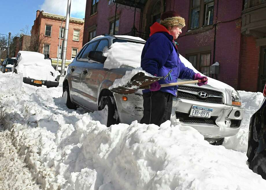 Kelly Bush of Albany clears snow around her car on Dove St. on Thursday, March 16, 2017 in Albany, N.Y. ( Lori Van Buren / Times Union) Photo: Lori Van Buren