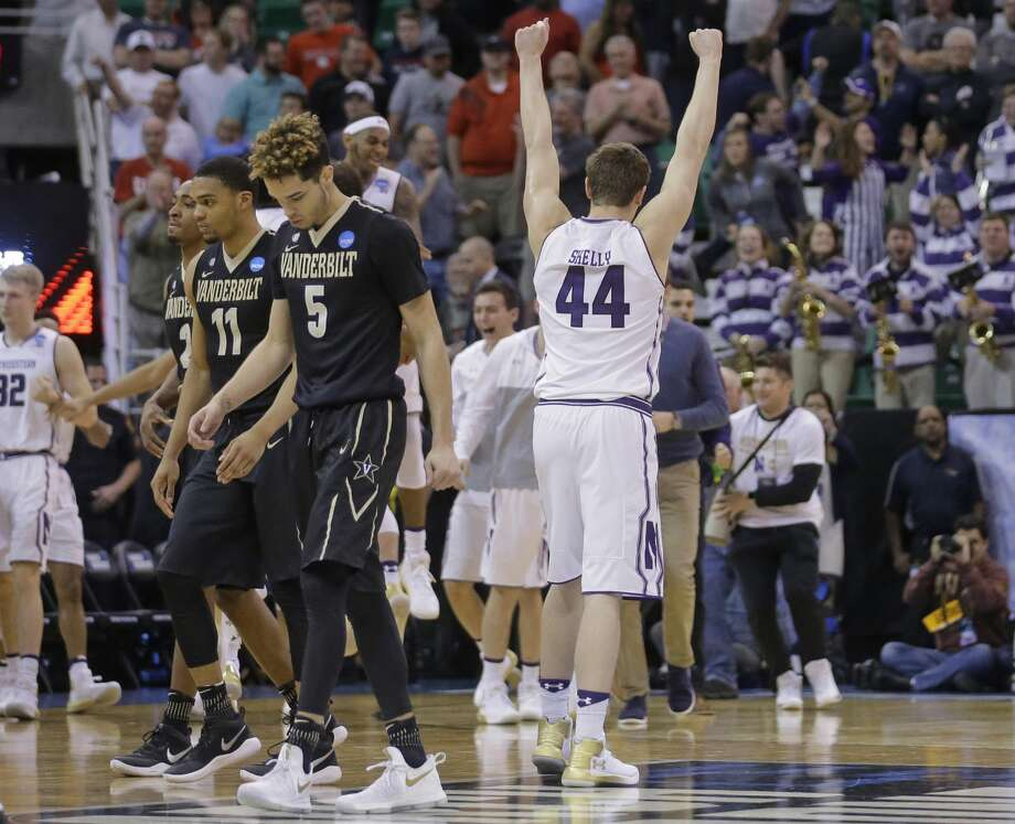 Northwestern forward Gavin Skelly (44) celebrates as Vanderbilt's Joe Toye (2), Jeff Roberson (11), and Matthew Fisher-Davis (5) walk off the court following their first-round men's college basketball game in the NCAA Tournament Thursday, March 16, 2017, in Salt Lake City. Northwestern won 68-66. (AP Photo/Rick Bowmer) Photo: Rick Bowmer/Associated Press