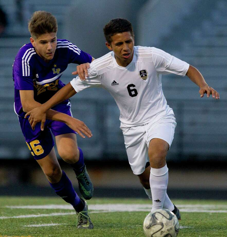 Conroe midfielder Gustavo Jaurigul (6) gets past Lufkin midfielder Javier Palomar (26) during the first period of a District 12-6A high school boys soccer match at Buddy Moorhead Stadium Thursday, March 2, 2017, in Conroe. Conroe defeated Lufkin 2-0. Photo: Jason Fochtman, Staff Photographer / © 2017 Houston Chronicle