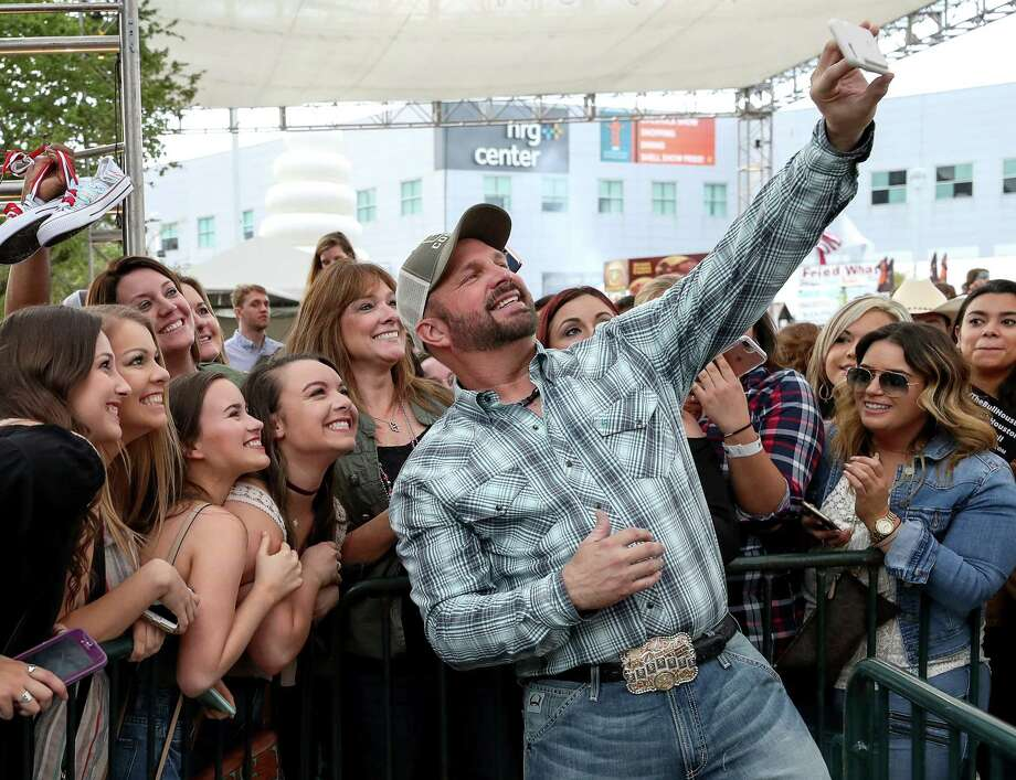 Country legend Garth Brooks takes selfies with fans at RodeoHouston Thursday after  announcing he will return to the stage after a 25-year hiatus.  Photo: Jon Shapley, Staff / © 2017 Houston Chronicle