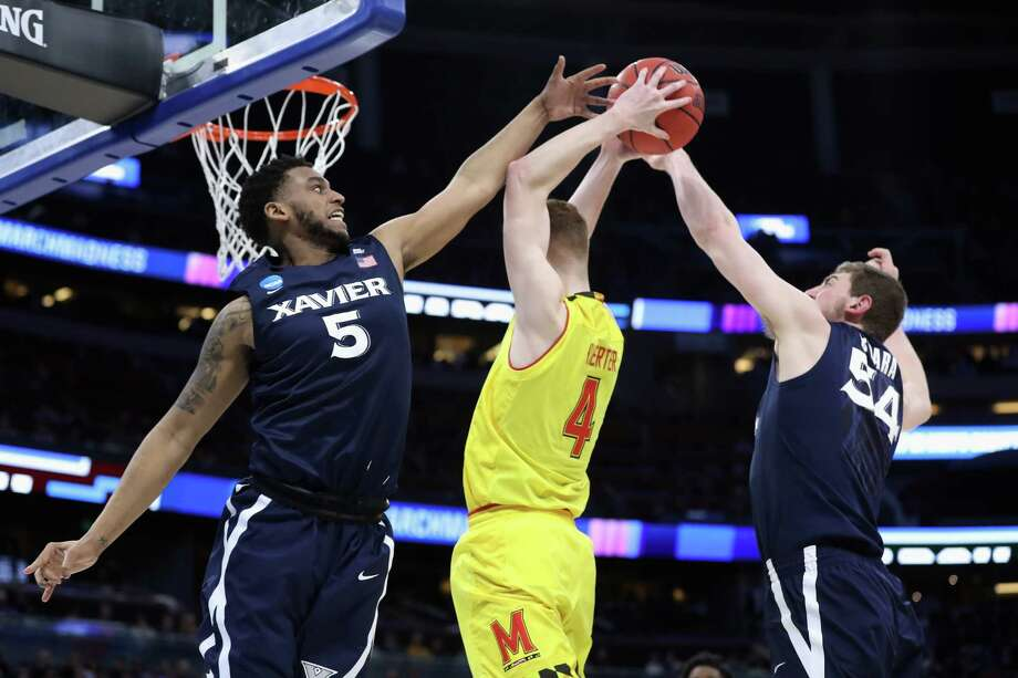ORLANDO, FL - MARCH 16:  Kevin Huerter #4 of the Maryland Terrapins drives to the basket against Trevon Bluiett #5 of the Xavier Musketeers and Sean O'Mara #54 in the second half during the first round of the 2017 NCAA Men's Basketball Tournament at Amway Center on March 16, 2017 in Orlando, Florida.  (Photo by Rob Carr/Getty Images) ORG XMIT: 686515181 Photo: Rob Carr / 2017 Getty Images