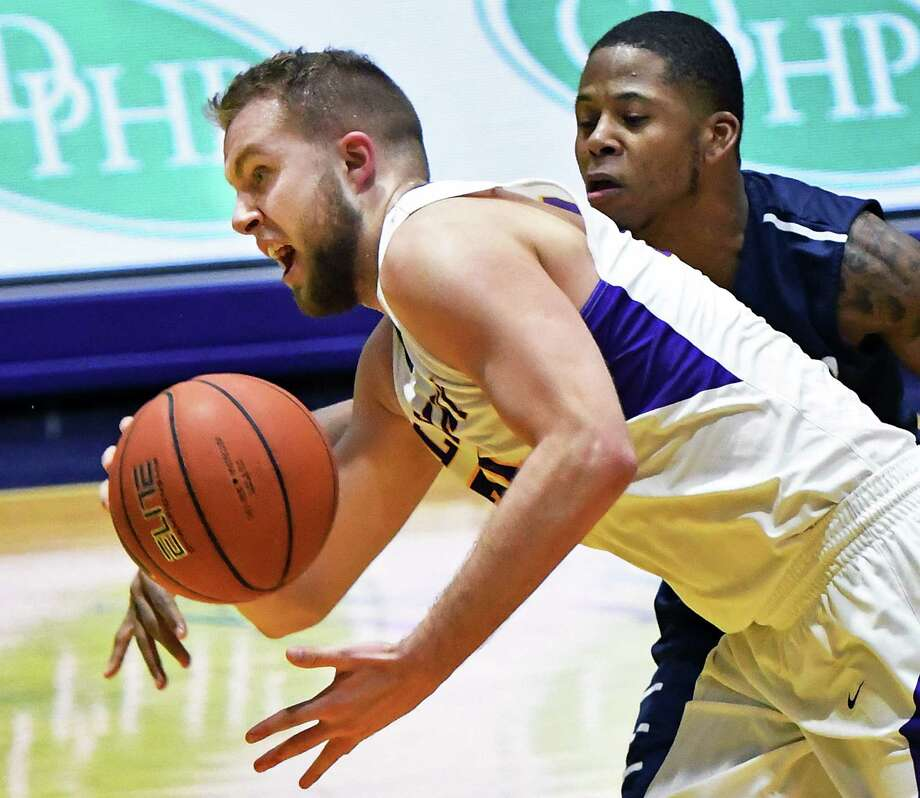 UAlbany's #24 Dallas Ennema, left, battles Saint Peter's  #3 Trevis Wyche for a loose ball during their CIT Tournament game Thursday March 16, 2017 in Albany, NY.  (John Carl D'Annibale / Times Union) Photo: John Carl D'Annibale / 20039961A