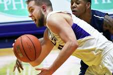UAlbany's #24 Dallas Ennema, left, battles Saint Peter's  #3 Trevis Wyche for a loose ball during their CIT Tournament game Thursday March 16, 2017 in Albany, NY.  (John Carl D'Annibale / Times Union)