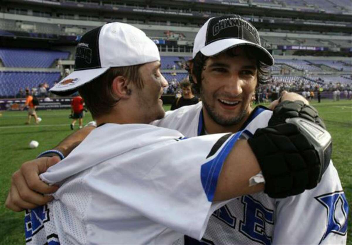 Duke's Brandon Allen, left, hugs teammate CJ Costabile after Duke defeated Norte Dame 6-5 in overtime to win the NCAA men's lacrosse tournament championship game Monday, May 31, 2010, in Baltimore. (AP Photo/Rob Carr)