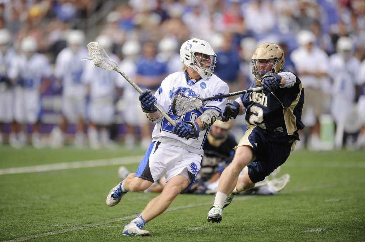 BALTIMORE, MD - MAY 31: Steve Schoeffel #20 of the Duke Blue Devils looks to make a pass against Taylor Tripucka #2 of the the Notre Dame Fighting Irish during the 2010 NCAA Division 1 Lacrosse Championship game on May 31, 2010 at M&T Bank Stadium in Baltimore, Maryland. (Photo by Mitchell Layton/Getty Images) *** Local Caption *** Steve Schoefel;Taylor Tripucka