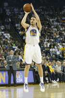 Klay Thompson (11) of the Golden State Warriors shoots a three during the first quarter of his NBA basketball game against Orlando Magic at Oracle Arena in Oakland, Calif. on Thursday, March 16, 2017.