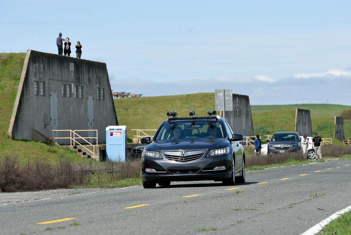 A self-driving Accura RLX runs in manual mode as Honda tests it's automated vehicles on the test track at GoMentum Station at the old Concord Naval Weapons Depot in Concord, CA, on Thursday March 16, 2017.