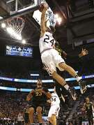 St. Mary's sharp-shooter Calvin Hermanson soars in for a dunk over VCU's Mo Alie-Cox.