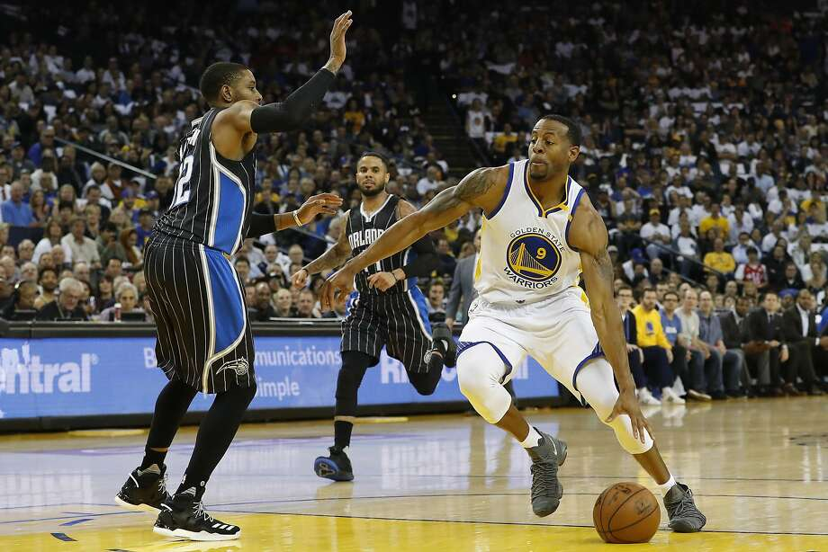 Andre Iguodala (9) of the Golden State Warriors dribbles the ball during the second quarter of his NBA basketball game against the Orlando Magic at Oracle Arena in Oakland, Calif. on Thursday, March 16, 2017. Photo: Stephen Lam, Special To The Chronicle