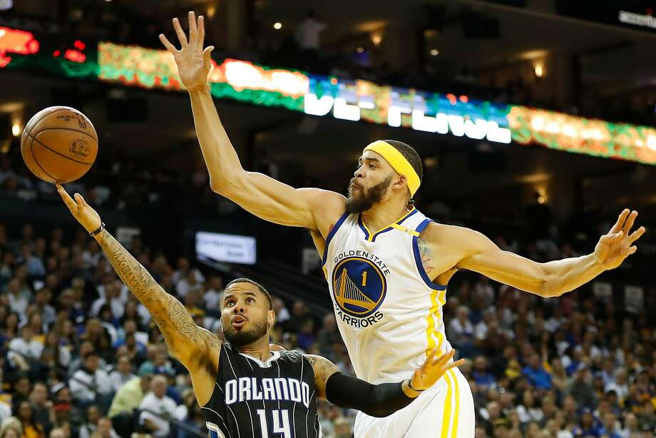 JaVale McGee defends during the third quarter of their NBA basketball game at Oracle Arena in Oakland on Thursday, March 16, 2017. The Warriors defeated the Magic 122-92. Photo: Stephen Lam, Special To The Chronicle