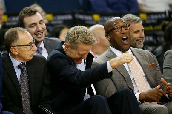 Assistant Coach Ron Adams, Head Coach Steve Kerr and Assistant Coach Mike Brown reacts from the sideline after a dunk during the fourth quarter of their NBA basketball game against the Orlando Magic at Oracle Arena in Oakland, Calif. on Thursday, March 16, 2017. The Warriors defeated the Magic 122-92.