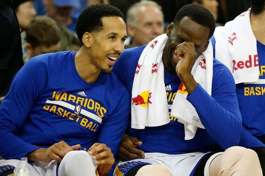 Shaun Livingston (34), left, shares a laugh with teammate Draymond Green (23) during the fourth quarter of their NBA basketball game against the Orlando Magic at Oracle Arena in Oakland, Calif. on Thursday, March 16, 2017. The Warriors defeated the Magic 122-92. Photo: Stephen Lam, Special To The Chronicle