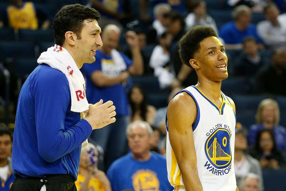 Zaza Pachulia (27), left, shares a laugh with teammate Patrick McCaw (0) of the Golden State Warriors during the fourth quarter of their NBA basketball game against the Orlando Magic at Oracle Arena in Oakland, Calif. on Thursday, March 16, 2017. The Warriors defeated the Magic 122-92. Photo: Stephen Lam, Special To The Chronicle